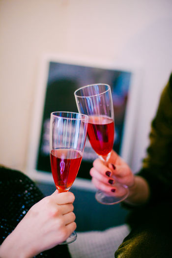 Glass Human Hand Refreshment Food And Drink Alcohol Drink Wine Holding Hand Lifestyles Celebration Human Body Part Women Leisure Activity Real People Focus On Foreground Wineglass People Champagne Flute Celebratory Toast Finger Red Wine Celebration