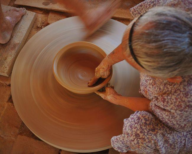 High Angle View Of Woman Making Pot