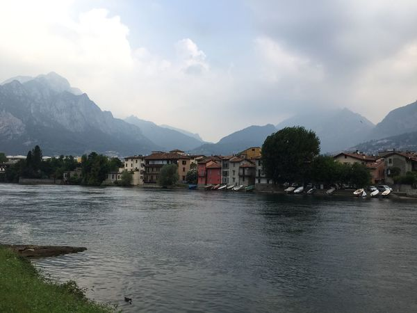 Mountain Water Waterfront Architecture Built Structure Building Exterior Mountain Range Sky Mid Distance Rippled Cloud Tranquil Scene River Scenics Cloud - Sky Tranquility In Front Of Nature Calm Lecco