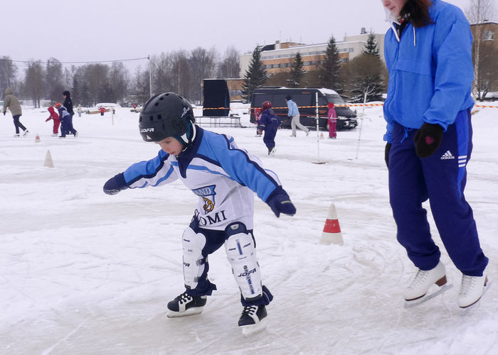 Child Childhood Cold Temperature Day Friendship Frozen Full Length Fun Hockey Human Body Part Ice Skate Leisure Activity Outdoors People Snow Warm Clothing Winter Winter Sport Snow Sports