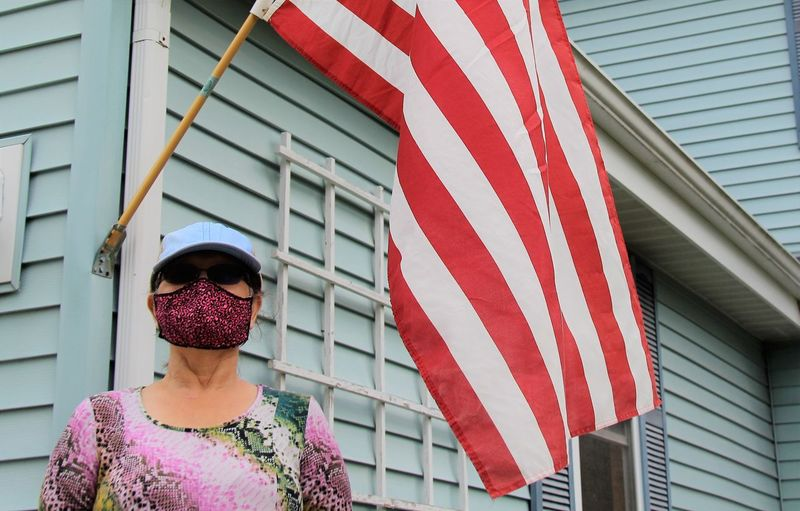 Low angle view of woman admiring united states flag