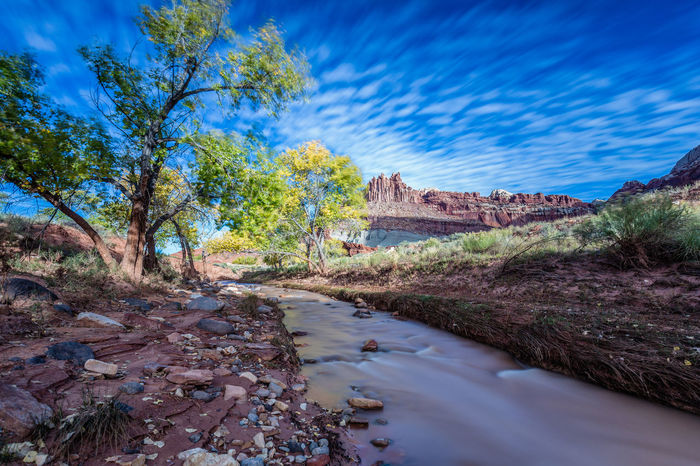 America Beauty In Nature Blue Capitol Reef National Park Creepy Day Footpath Mountain Nature No People Outdoors River Road Sky Stones The Castle The Way Forward Travel Destinations Tree USA Water Water Reflections