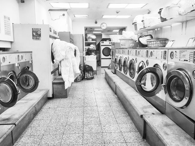 Laundrette Washing Machine Laundromat Laundry Indoors  Machinery Lifestyles One Person Customer  Store Large Group Of Objects Retail  Full Length Adults Only Men Young Adult One Man Only Adult Only Men People Day Blackandwhite Postcode Postcards