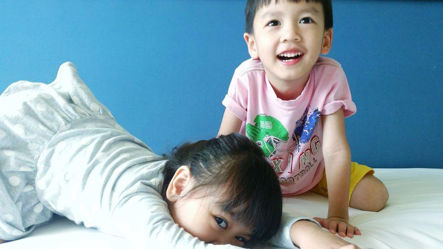 Portrait of happy siblings