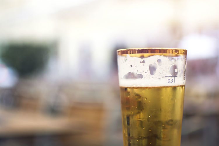 A glass of beer with scale volume 0.3 liter Refreshment Beer Drink Beer - Alcohol Drinking Glass Alcohol Food And Drink Glass Household Equipment Beer Glass Focus On Foreground No People Glass - Material Scale  Volume Foam Golden