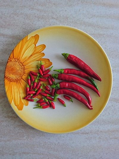 Pepper EyeEmNewHere Minimalism EyeEm Selects EyeEm Best Shots Sunflower Dish Multi Colored Directly Above Close-up Red Chili Pepper Chili  Pepper Spice Chili Pepper Prepared Food Serving Size