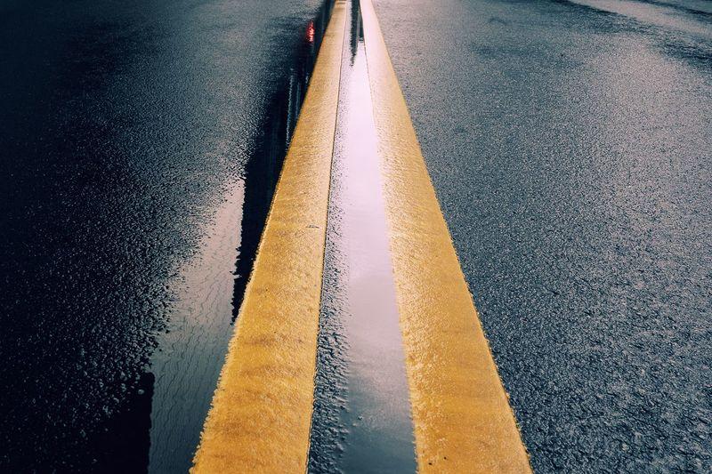 Full Frame Shot Of Wet Street During Rainy Season