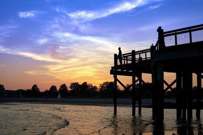 Sunset at Walnut Beach Dusk Pier Cloud - Sky Water Sea Beach Silhouette Business Finance And Industry Sky Horizon Over Water Cloud - Sky Built Structure Bridge - Man Made Structure Calm Evening