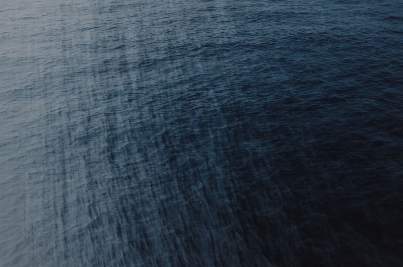 blue ocean surface Backgrounds Full Frame No People Pattern Water Blue Textured  Tranquility Rippled Sea High Angle View Nature Close-up Tranquil Scene Waterfront Beauty In Nature Motion Black Color Scenics - Nature Textured Effect Clean