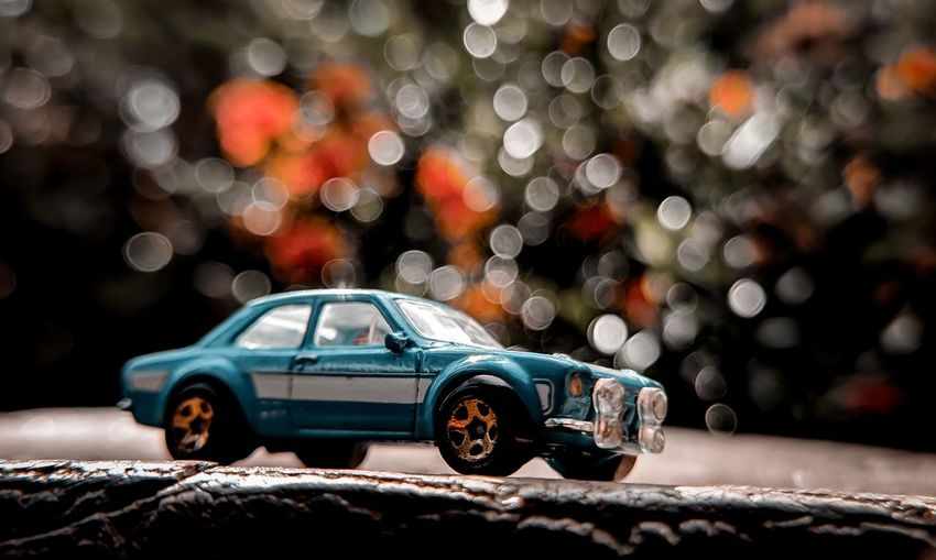Close-up of toy car on street at night