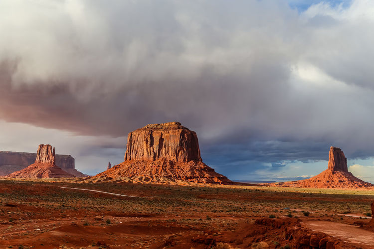 stormy weather above monument valley Desert Dramatic Sky Monument Valley Storm Arid Climate Beauty In Nature Cloud - Sky Clouds And Sky Desert Beauty Eroded Geology Golden Hour Landscape Nature Outdoors Physical Geography Rock Rock - Object Rock Formation Scenics - Nature Sky Stormy Sunset Tranquil Scene Travel Destinations