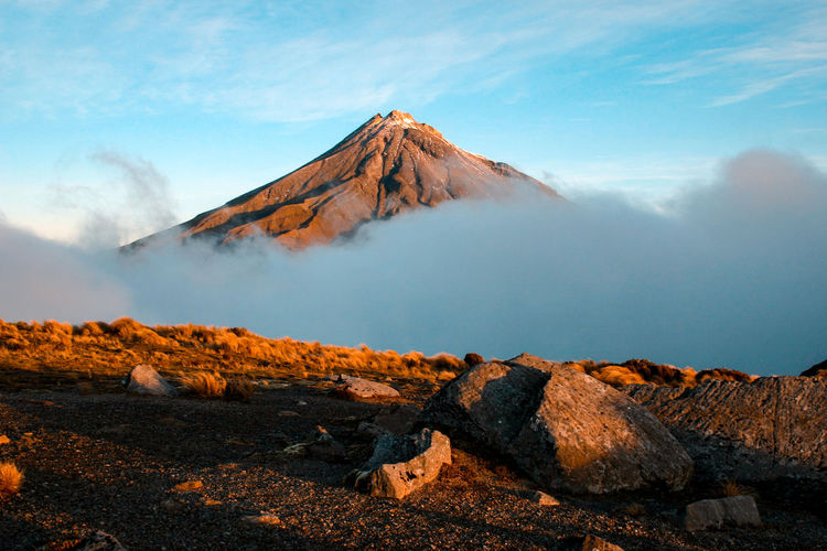 Mountain Scenics - Nature Beauty In Nature Landscape Tranquil Scene Sky Volcano Environment Tranquility Non-urban Scene Cloud - Sky Nature Smoke - Physical Structure Rock Geology No People Day Land Volcanic Landscape Solid Mountain Peak Outdoors Power In Nature Snowcapped Mountain Formation