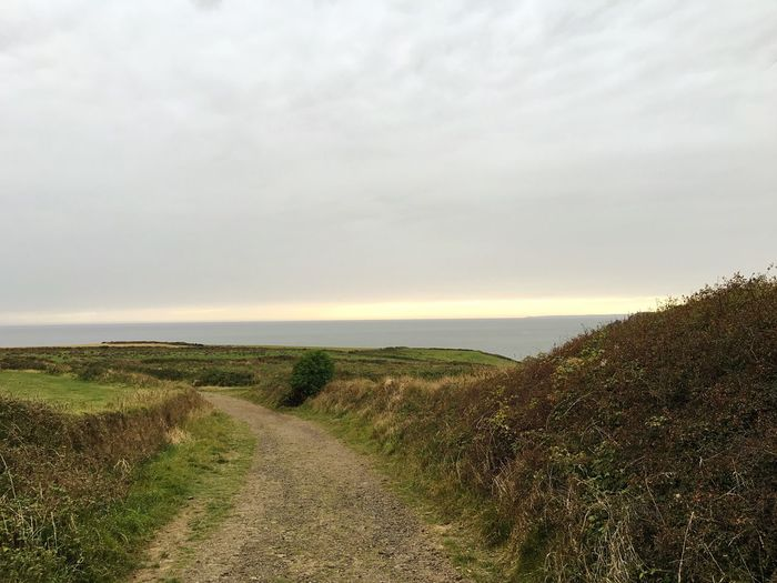The Way Forward Tranquil Scene Dirt Road Cloud - Sky Diminishing Perspective Scenics Non-urban Scene Beauty In Nature Sea And Sky Cornwall Lizard Peninsula Cornwall Walks Landscape Landscape_Collection