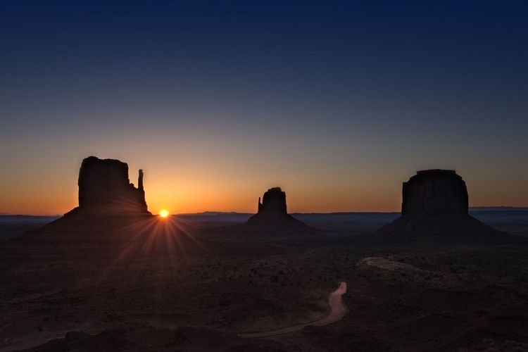 Rock formations in desert during sunset
