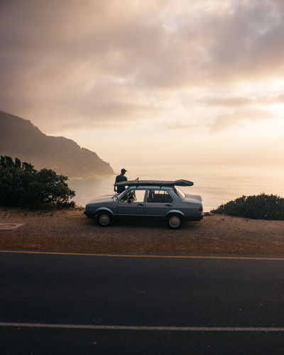 Road trip to the sun. Backgrounds Beauty In Nature Calm Car Cloud - Sky Clouds Day Jonnynichayes Land Vehicle Landscape Man And Car Mode Of Transport Mountain Nature Outdoors Road Road Trip Scenics Sky Sunset Sunset_collection Surf Transportation Tree Wallpaper