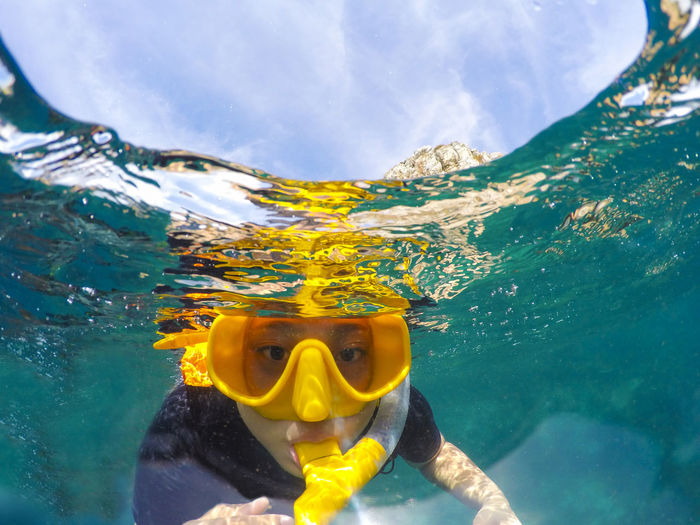 Portrait of teenage girl snorkeling in sea