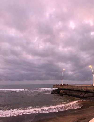 Cloud - Sky Sky Sea Water Beach Nature Architecture Built Structure No People Beauty In Nature Land Environment Scenics - Nature Building Exterior Pink Color Outdoors Tranquil Scene Dusk Dramatic Sky Purple