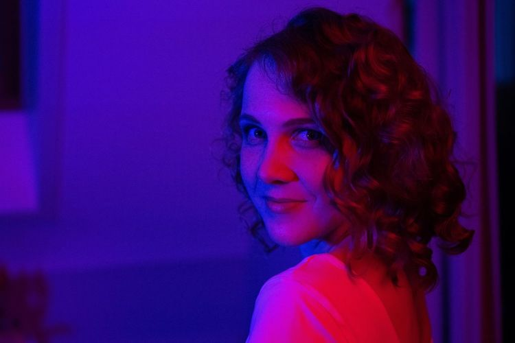 Adult Beautiful Woman Beauty Contemplation Dyed Hair Hair Hairstyle Headshot Illuminated Indoors  Lifestyles Looking At Camera Nightlife One Person Portrait Purple Real People Redhead Side View Women Young Adult Young Women