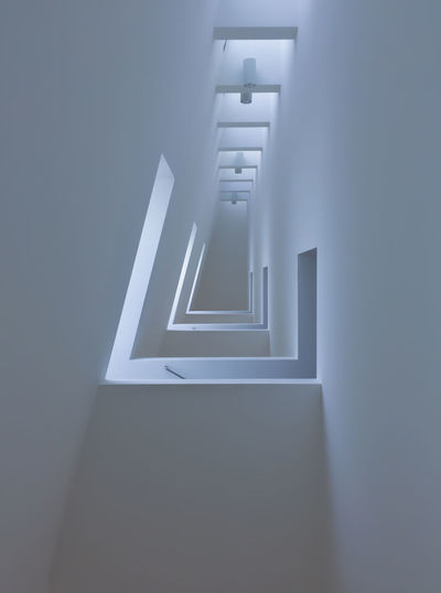 Low angle view of illuminated staircase at home building