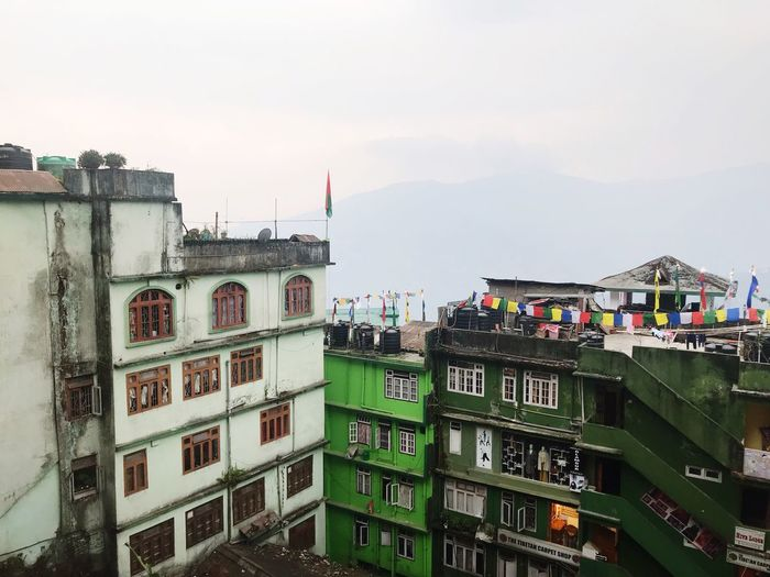 Gangtok Himalaya City Sikkim India Himalaya Building Exterior Architecture Built Structure Sky Building City Nature Residential District Outdoors Day No People Window Multi Colored Cloud - Sky Flag City Life Apartment