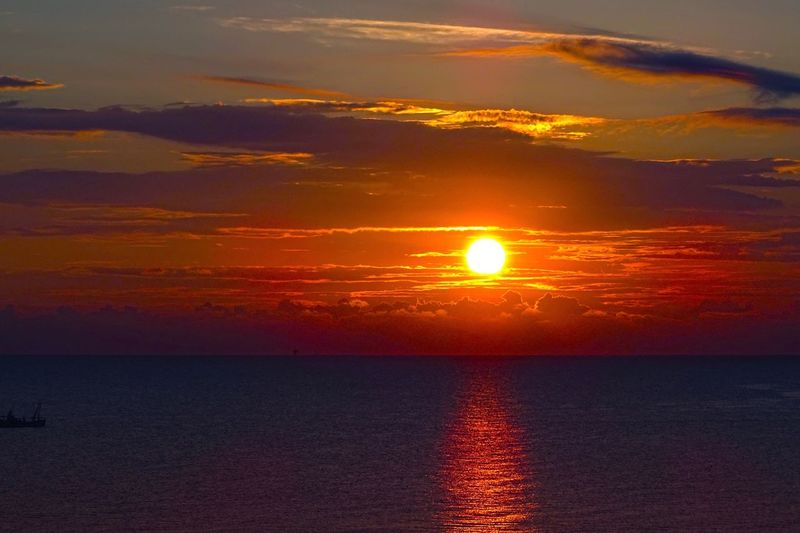 Sunrise Travel Travel Destinations Sunset Sky Beauty In Nature Water Sea Scenics - Nature Orange Color Idyllic Cloud - Sky Horizon Horizon Over Water Dramatic Sky Nature No People Sunlight Tranquil Scene Outdoors Sun Tranquility Reflection