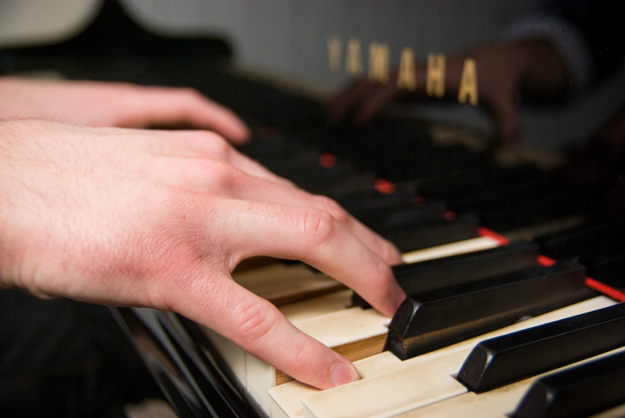 human hand, human body part, music, human finger, musical instrument, real people, one person, close-up, piano key, indoors, piano, arts culture and entertainment, playing, technology, keyboard, musician, day, people