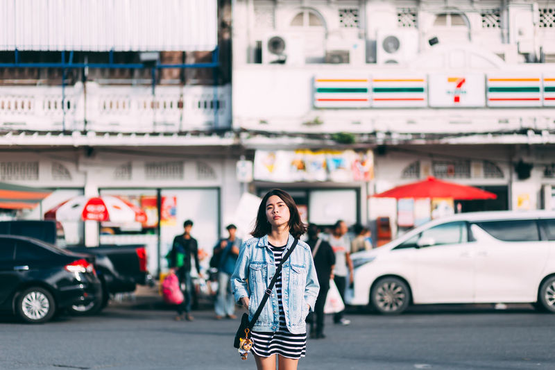 Portrait Of Woman Standing On Street In City