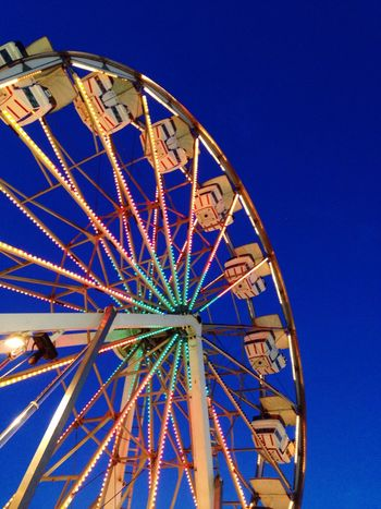 Low Angle View Amusement Park Arts Culture And Entertainment Ferris Wheel Clear Sky Blue Amusement Park Ride Traveling Carnival No People Outdoors Big Wheel Sky Illuminated Close-up Night Semi-circle