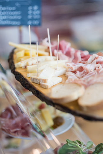 Delicious snack platter with cheese and ham on display on the buffet of a restaurant EyeEmNewHere Snack Buffet Cheese Close-up Food Food And Drink Freshness Healthy Eating Indoors  Indulgence Meat No People Plate Platter Pork Ready-to-eat Restaurant Selective Focus Serving Size Still Life Variation