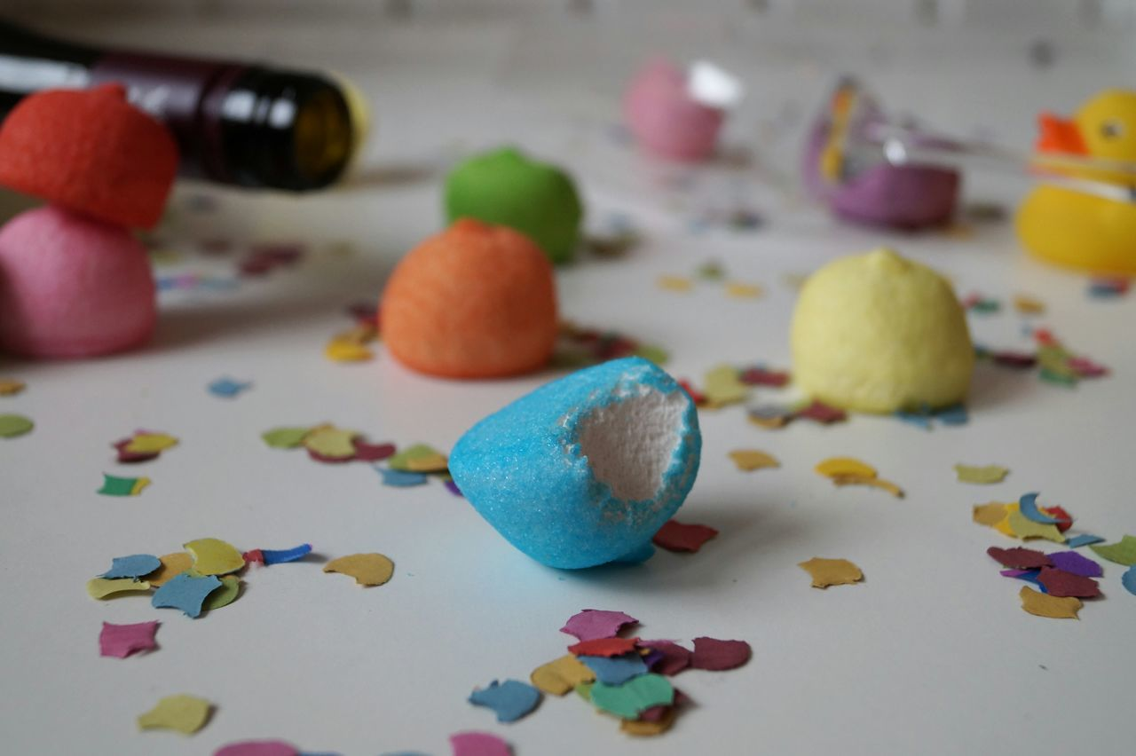 Close-Up Of Colorful Polystyrene With Artificial Feathers