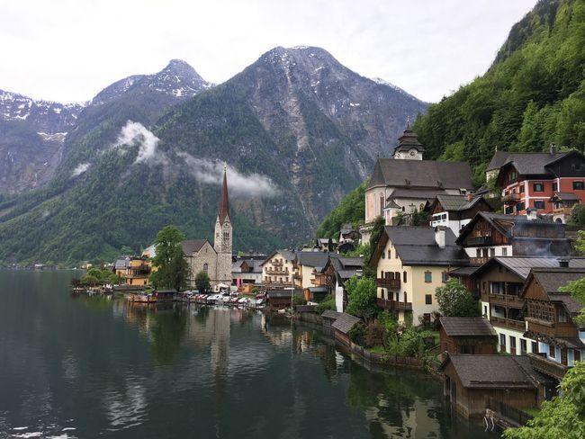 Hallstatt, Austria Architecture Beauty In Nature Building Exterior Built Structure Community Day House Lake Mountain Mountain Range Nature No People Outdoors Range Residential Building Scenics Sky Town Tree Water Waterfront