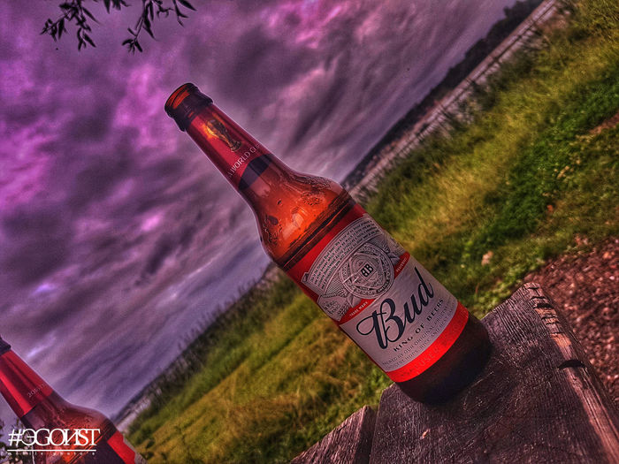great soon bud Spraying Alcohol Bottle Red Sky Close-up
