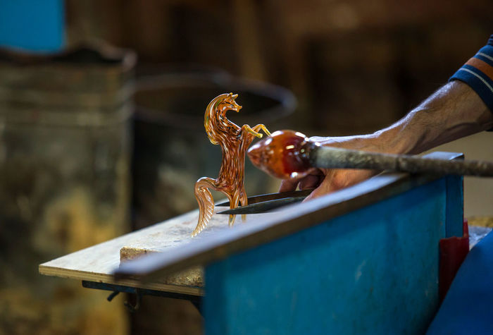 Animal Themes Animals In The Wild Close-up Day Factory Focus On Foreground Glass Glass - Material Glass Factory Human Hand Muranoglass One Animal One Person Outdoors Reptile