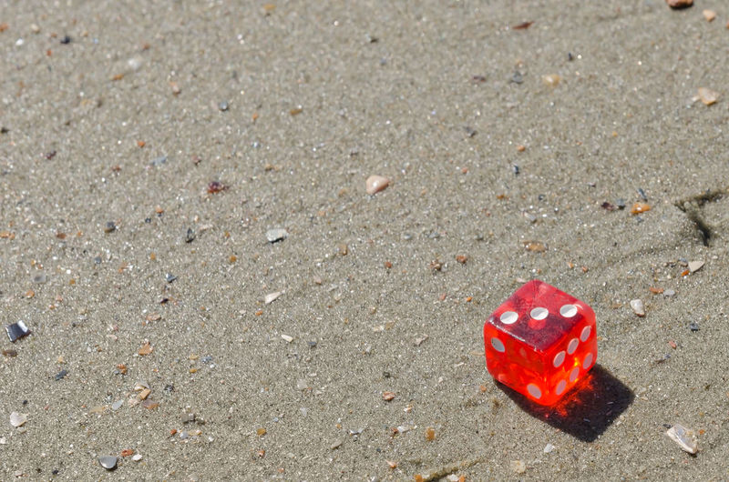 Red dice on sand Cube Dice Gamble, Gaming Isolated, Jackpot Leisure Activity Opportunity Success, Win,