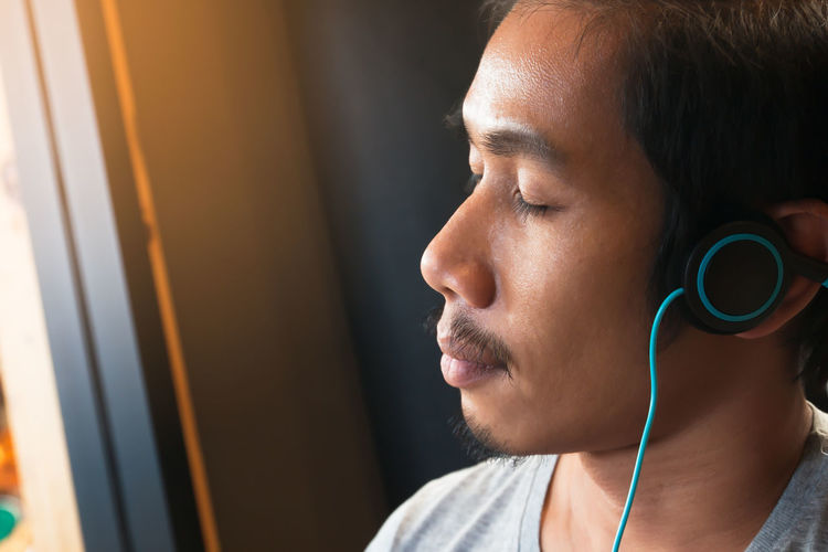 Close-Up Of Man Listening To Music