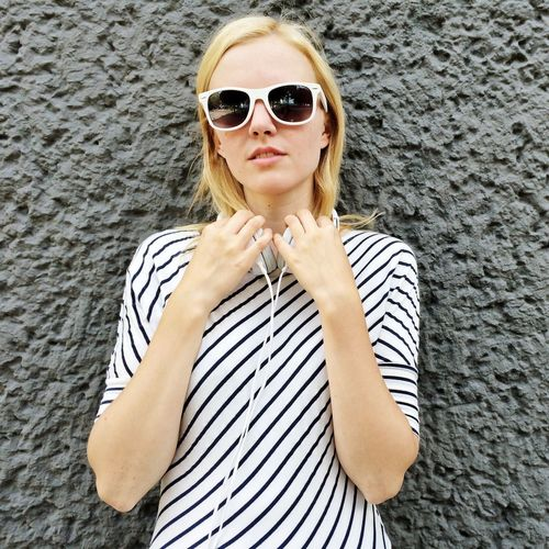 Woman Girl Sunglasses Hipster Blond Hair Portrait Beautiful Woman One Woman Only Only Women Front View Looking At Camera Young Adult Young Women Beautiful People One Person Summer Confidence  Adults Only Beauty One Young Woman Only Lifestyles Standing Outdoors Headphones