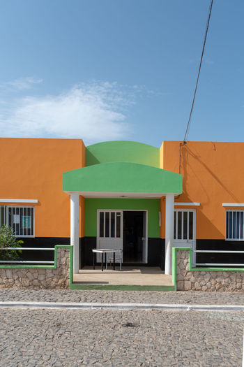 Hoffi99 Day Architecture Building Exterior Built Structure Building Sky No People Nature Window Outdoors Green Color Cloud - Sky Residential District City House Blue Orange Color Footpath Street Sunlight