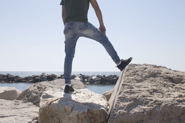 Beach Casual Clothing Clear Sky Day Jeans Leisure Activity Lifestyles Nature One Person Real People Sea Sky Water
