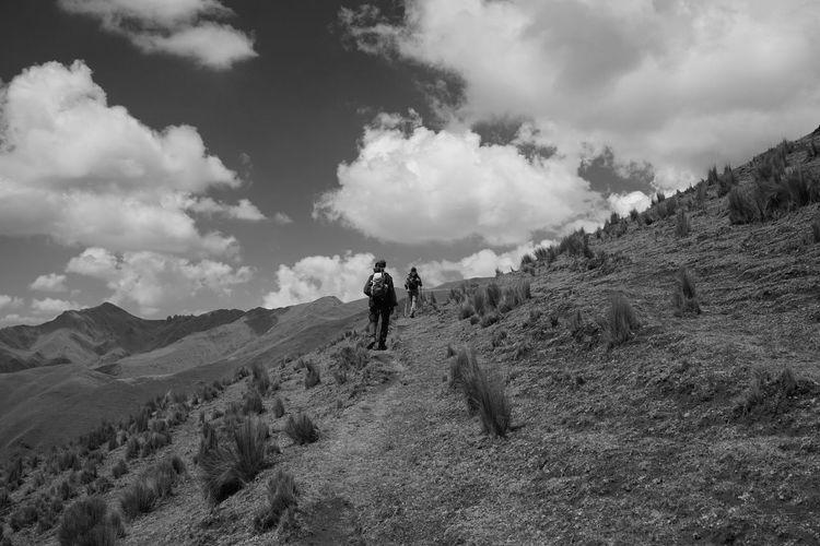 People walking on land against sky