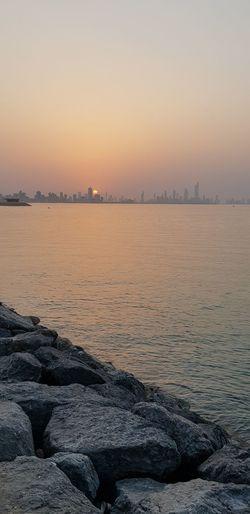 Sunset,Salmiya, Kuwait Urban Skyline Cityscape Sea Sunset Beach Water City Blue Business Finance And Industry Sky Scenics Romantic Sky Calm Horizon Over Water Dramatic Sky Moody Sky Atmospheric Mood Sky Only