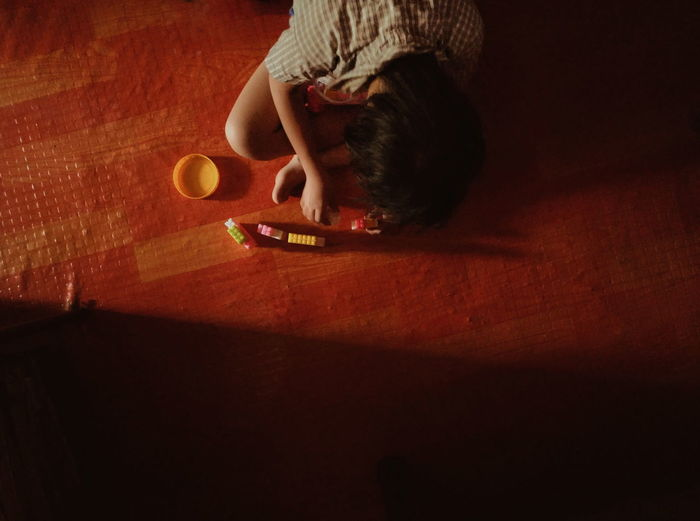 High angle view of boy sitting on table