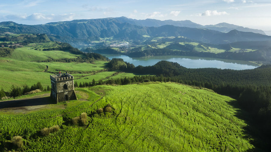 Aerial view of castelo branco historic castle with furnas lagoon on background in sao miguel, azores