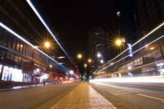 Illuminated Long Exposure City Street Built Structure Architecture Street Light Traffic Land Vehicle Downtown District No People Night Transportation City Road Street Light Low Angle Shot Building Exterior Bridge - Man Made Structure Speed Car Sky Connection Outdoors