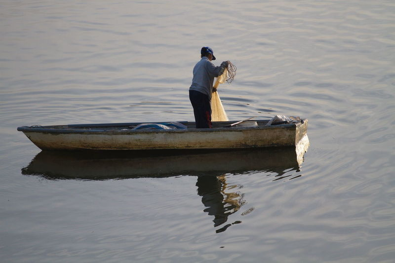 Boat Catchin Fish Day Fisherman Human Interest Nature Netting One Person Outdoors People Real People Reflection Water Woman The Week On EyeEm