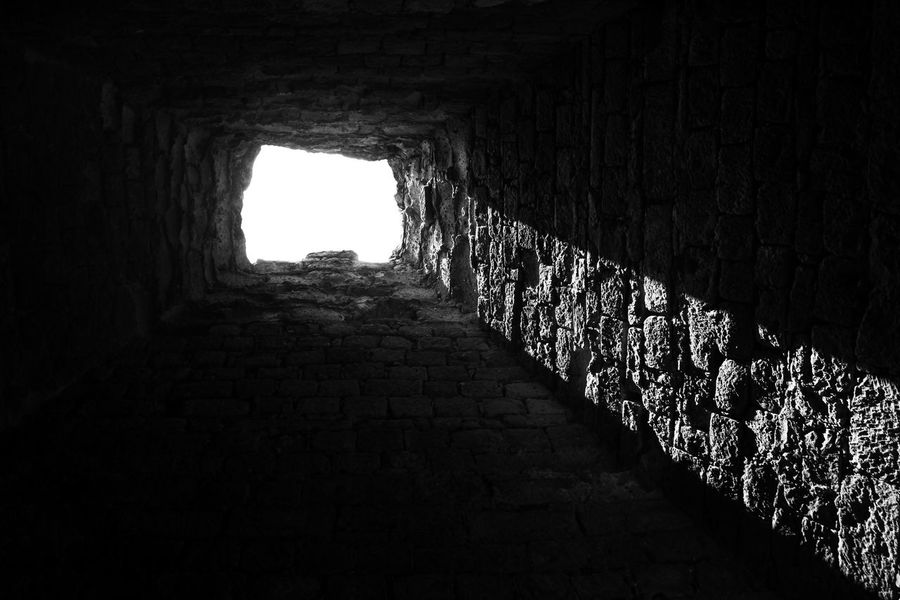 From the shadows to the light Ancient Civilization Arch Architecture Black And White Black And White Photography Built Structure Day History Indoors  Light At The End Of The Tunnel No People Sunlight The Way Forward Tunnel Walkway