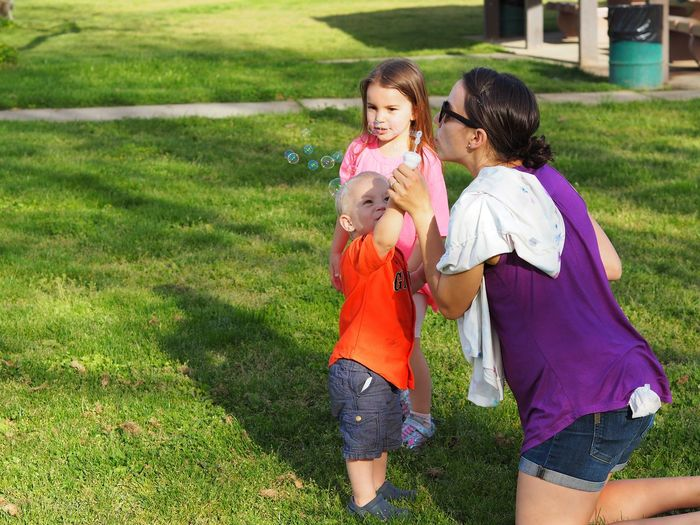 Bubbles Child Friendship Childhood Females Togetherness Girls Bonding Full Length Daughter Lawn