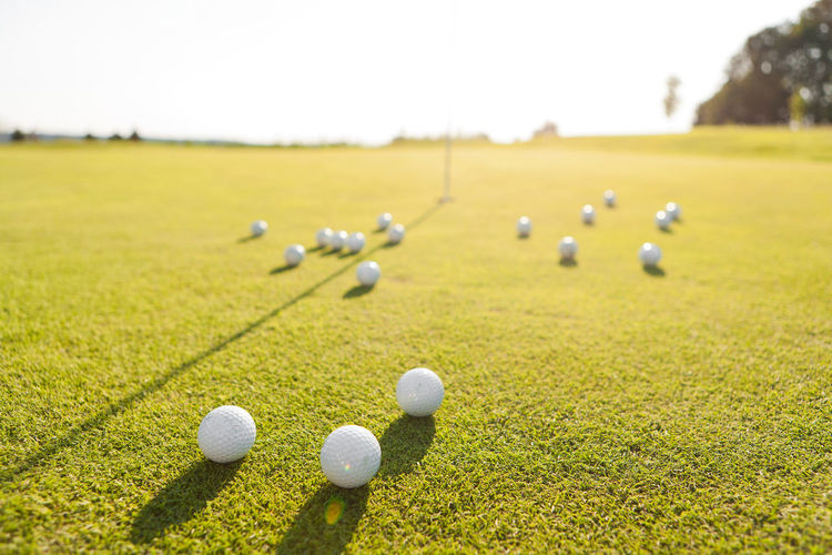 Close-Up Of Golf Balls On Grass