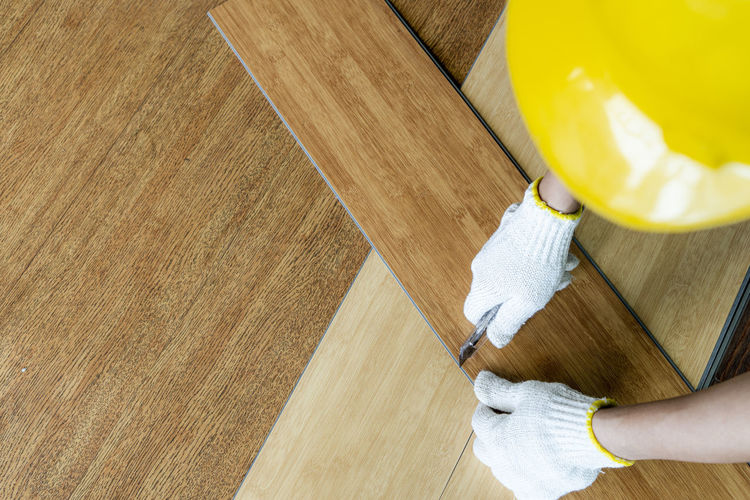 High angle view of man working on floor at home