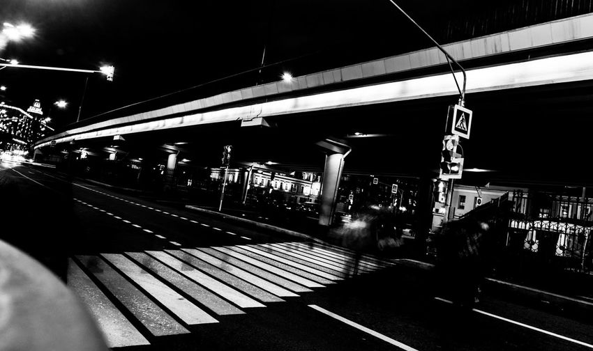 Cross Nightphotography Road Architecture Built Structure Cross Walk Men Night Outdoors People Public Transportation Rail Transportation Railroad Station Railroad Station Platform Railroad Track Real People Sky Streetphotography Train - Vehicle Transportation