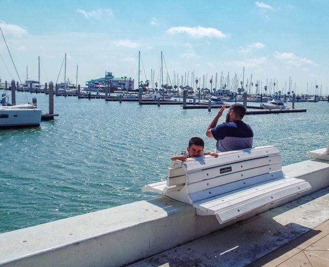 Nautical Vessel Two People Sea Harbor Adult Cloud - Sky Sky Water Moored Togetherness People Ship Day Outdoors Commercial Dock Boy Child On The Edge Bench People Watching Sunny Day On The Phone Corpus Christi, Tx Breathing Space The Week On EyeEm